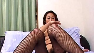 Short haired Japanese brunette in stockings teases cunt with egg love toy
