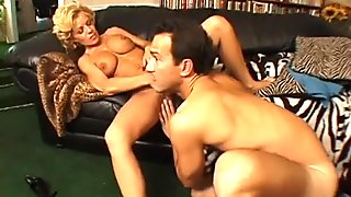 Huge boobed hottie is riding big fat cock in a cowgirl pose