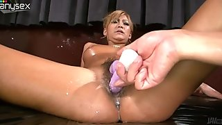 Sizzling oiled up hottie from Japan gets her hairy muff fucked with vibrating sex toy