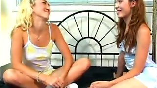 two young blonde and brunette lesbian girl explore pussy-