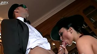 Juggy chick in hat and corset jerks off dick and sends it deep in her throat